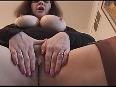 Busty mature with hairy pussy adjacent to mini skirt plays with panties and teases