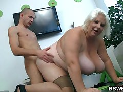 Huge fair-haired lady gets doggystyled