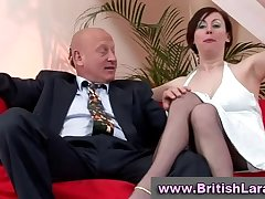 Grown up british lady in stockings is licked by businessman