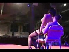 Stripper on stage teasing guy