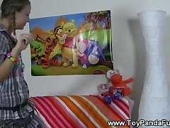 Pigtail teen playing explicitly with dolls