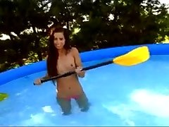 Hot teen Kiki fooling around in the air her outdoor swimming pool