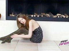 Skiny teen teasing in shiny pantyhose and panties.