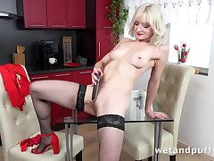 Sexy blonde give stockings pleases herself with dildo