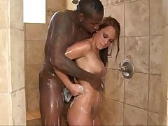 Masseuse gives blowjob to lucky black guy